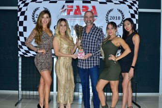 David Tuaty accepts the FARA MP1A Sprint Championship trophy for his team