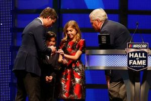 Rick Hendrick, Leo Gordon and Ella Gordon present a ring to Jeff Gordon