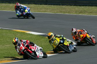 Roberto Locatelli, Andrea Dovizioso, Casey Stoner y Angel Nieto