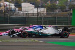 Valtteri Bottas, Mercedes AMG W10, passes Lance Stroll, Racing Point RP19