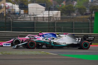 Valtteri Bottas, Mercedes AMG W10, passes Lance Stroll, Racing Point RP19