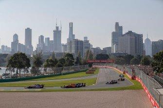 Lance Stroll, Racing Point RP19, leads Carlos Sainz Jr., McLaren MCL34, Antonio Giovinazzi, Alfa Romeo Racing C38, Daniil Kvyat, Toro Rosso STR14, and Pierre Gasly, Red Bull Racing RB15