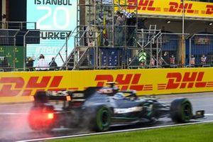 Valtteri Bottas, Mercedes F1 W11, passes the chequered flag