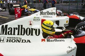 Ayrton Senna, McLaren MP4/6 Honda, and Gerhard Berger, McLaren MP4/6 Honda, wait to pull out into the pitlane