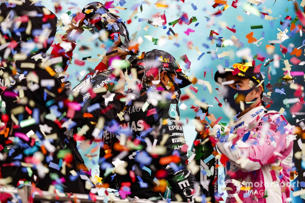 Lewis Hamilton, Mercedes-AMG F1, celebrates on the podium after winning the race, to take his 7th World Championship title, with Sergio Perez, Racing Point, 2nd position,