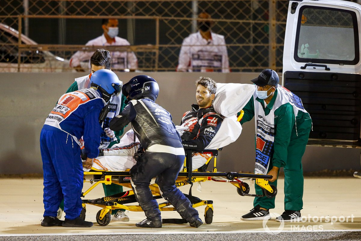 Romain Grosjean, Haas F1, is taken away on a stretcher after his opening lap crash