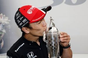 2020 Indy 500 winner Takuma Sato is presented with the Baby Borg-Warner Trophy