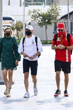 Valtteri Bottas, Mercedes-AMG F1, and Sebastian Vettel, Ferrari, arrive at the circuit