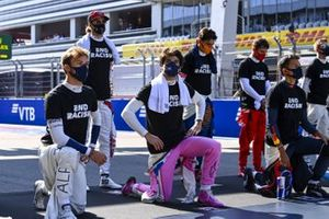 Pierre Gasly, AlphaTauri, Antonio Giovinazzi, Alfa Romeo, Lance Stroll, Racing Point, Carlos Sainz Jr., McLaren, Charles Leclerc, Ferrari, and Alex Albon, Red Bull Racing, stand and kneel in support of the End Racism campaign