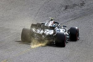 Sparks kick up from the rear of Valtteri Bottas, Mercedes F1 W11
