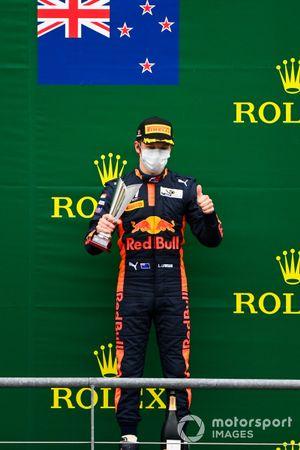 Liam Lawson, Hitech Grand Prix celebrates on the podium with the trophy