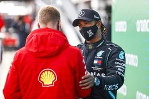 Mick Schumacher congratulates Lewis Hamilton, Mercedes-AMG F1, 1st position, on equalling his fathers race win record of 91
