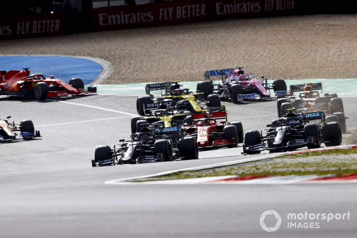 Lewis Hamilton, Mercedes F1 W11, battles with Valtteri Bottas, Mercedes F1 W11, for the lead at the start ahead of the rest of the field