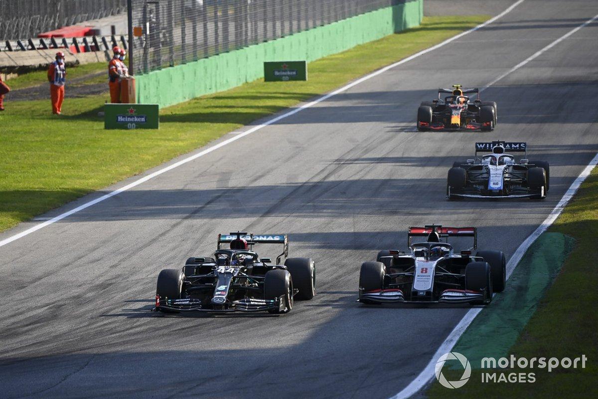 Lewis Hamilton, Mercedes F1 W11, Romain Grosjean, Haas VF-20, and George Russell, Williams FW43