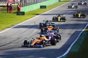 Carlos Sainz Jr., McLaren MCL35, Lance Stroll, Racing Point RP20 and Lando Norris, McLaren MCL35
