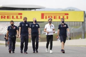 Pierre Gasly, AlphaTauri, walks the track with colleagues