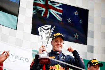 Race winner Juri Vips, Hitech Grand Prix celebrates on the podium with the trophy