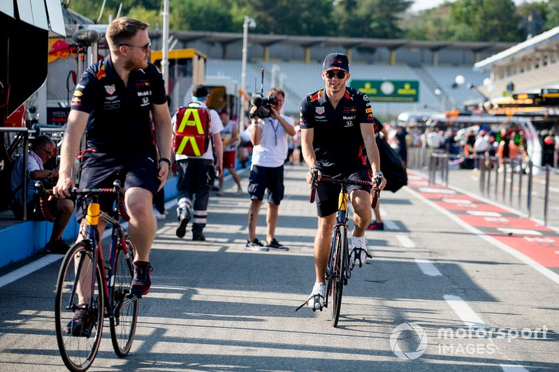 Pierre Gasly, Red Bull Racing rides down the pitman on a bike