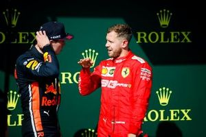 Max Verstappen, Red Bull Racing, 2nd position, talks with Sebastian Vettel, Ferrari, 3rd position, on the podium