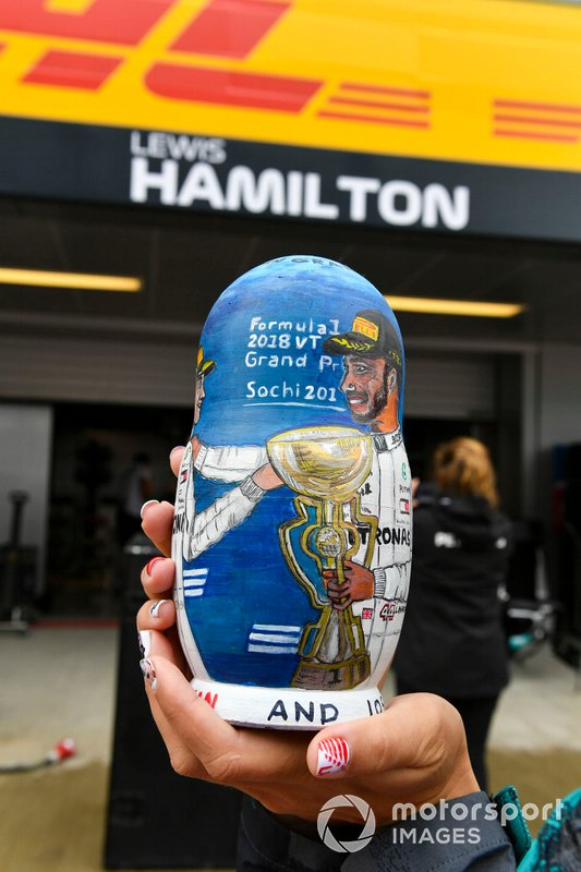 A matryoshka doll with an image of Lewis Hamilton, Mercedes AMG F1, painted on it