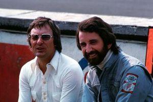 Bernie Ecclestone, Brabham Team owner with John Watson, Brabham