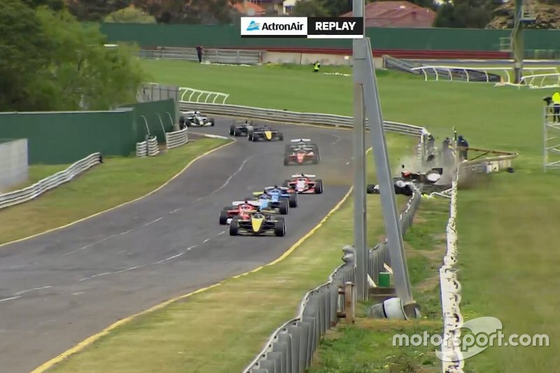 James Golding, Garry Rogers Motorsport leads Rubens Barrichello, Team BRM as Alex Davison suffers a crash