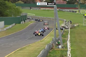 James Golding, Garry Rogers Motorsport leads Rubens Barrichello, Team BRM as Alex Davison suffers a crash