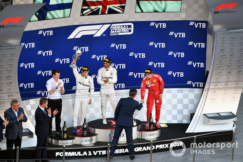 Fred Judd, Chief Engineer Trackside, Mercedes AMG F1, Valtteri Bottas, Mercedes AMG F1, 2nd position, Lewis Hamilton, Mercedes AMG F1, 1st position, and Charles Leclerc, Ferrari, 3rd position, on the podium