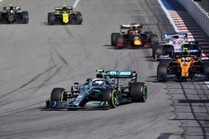 Valtteri Bottas, Mercedes AMG W10, leads Lando Norris, McLaren MCL34, Sergio Perez, Racing Point RP19, Max Verstappen, Red Bull Racing RB15, Nico Hulkenberg, Renault F1 Team R.S. 19, and Kevin Magnussen, Haas F1 Team VF-19