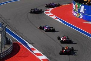 Lance Stroll, Racing Point RP19, leads Pierre Gasly, Toro Rosso STR14, Daniil Kvyat, Toro Rosso STR14, Kimi Raikkonen, Alfa Romeo Racing C38, and Alex Albon, Red Bull RB15