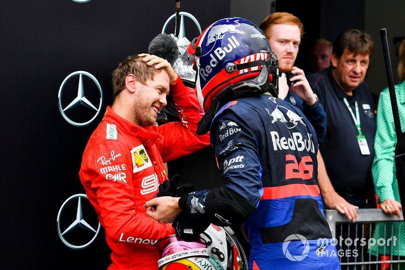 Sebastian Vettel, Ferrari and Daniil Kvyat, Toro Rosso celebrate in Parc Ferme
