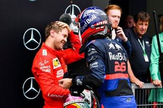 Себастьян Феттель, Ferrari, и Даниил Квят, Scuderia Toro Rosso
