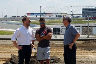 SMI President Marcus Smith, NASCAR driver Bubba Wallace and Charlotte Motor Speedway Executive Vice-President and General Manager Greg Walter