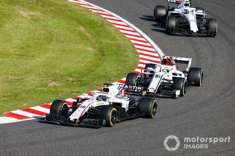 Lance Stroll, Williams FW41, leads Charles Leclerc, Sauber C37, and Sergey Sirotkin, Williams FW41