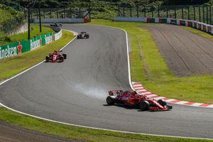 Sebastian Vettel, Ferrari SF71H leads Kimi Raikkonen, Ferrari SF71H