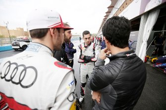 The drivers meet in the pit lane