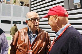 Dorna CEO Carmelo Ezpeleta with Niki Lauda