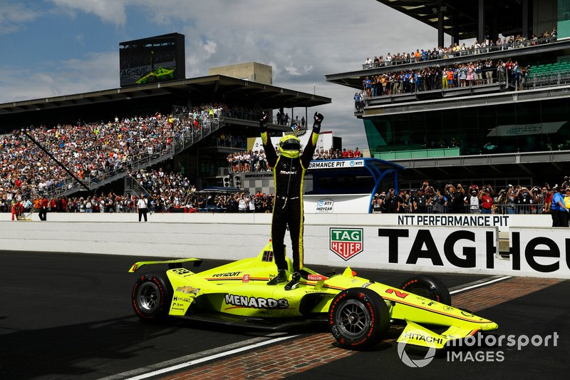 Simon Pagenaud, Team Penske Chevrolet celebrates the win on the track over the yard of bricks