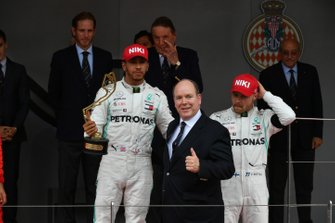 Lewis Hamilton, Mercedes AMG F1, 1st position, with his trophy alongside Prince Albert II on the podium