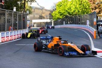Carlos Sainz Jr., McLaren MCL34, leads Daniel Ricciardo, Renault R.S.19, and Charles Leclerc, Ferrari SF90