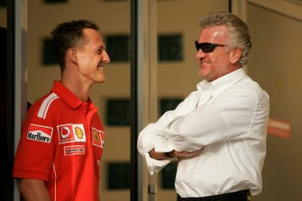 Michael Schumacher, Ferrari talks to manager Willi Weber