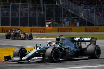 Lewis Hamilton, Mercedes AMG F1 W10, leads Kevin Magnussen, Haas VF-19
