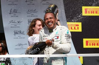 Lewis Hamilton, Mercedes AMG F1, 1st position, celebrates with his team mate on the podium