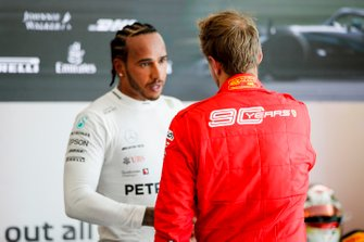 Lewis Hamilton, Mercedes AMG F1, 1st position, shakes hands with Sebastian Vettel, Ferrari, 2nd position, after the race