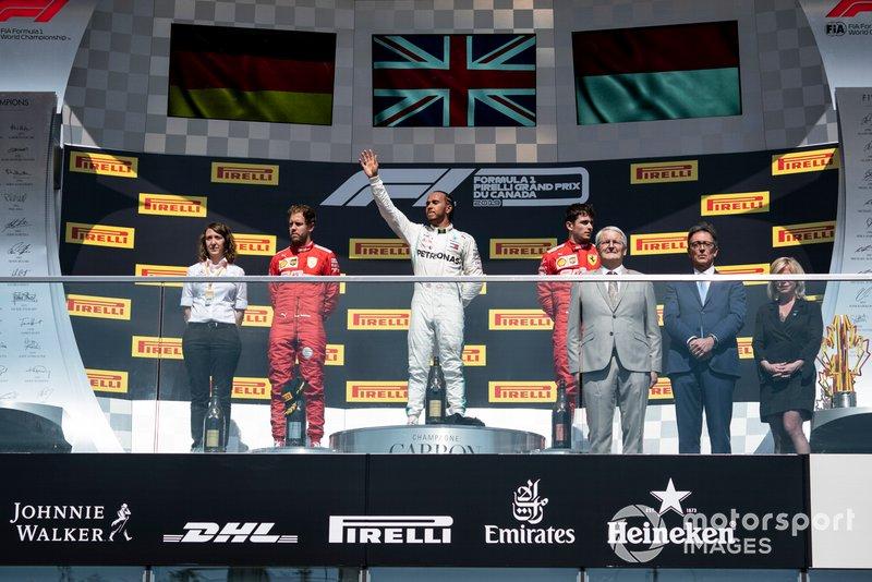 Sebastian Vettel, Ferrari, 2nd position, Lewis Hamilton, Mercedes AMG F1, 1st position, and Charles Leclerc, Ferrari, 3rd position, on the podium