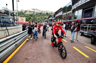 Charles Leclerc, Ferrari on a bike in the pit lane