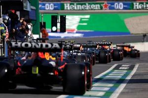 Lewis Hamilton, Mercedes W12, and Max Verstappen, Red Bull Racing RB16B, in the pit lane