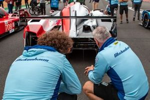 Glickenhaus Racing members check out the Toyota Gazoo Racing GR010