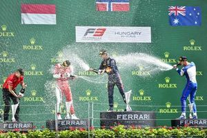 Arthur Leclerc, Prema Racing, Race Winner Dennis Hauger, Prema Racing and Jack Doohan, Trident celebrate on the podium with the champagne