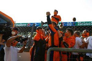 The McLaren team celebrate victory